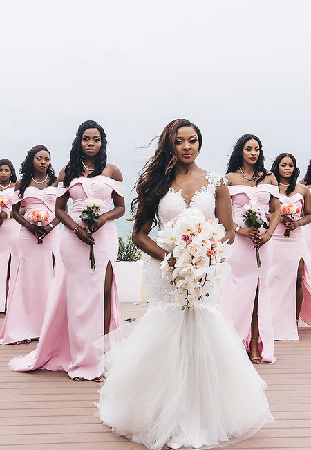 Real wedding cindy glen black bride with hair down in lace dress with cascading bouquet with her bridesmaids in pink dresses with small bouquets stanlo photography